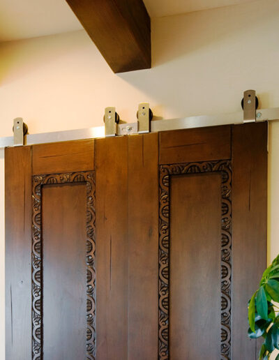 Double-Barn-Doors-Track-custom-Hardware-and-carved-trim