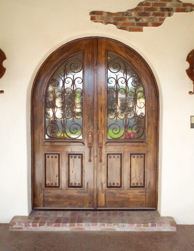 Double Roundtop Entry door with Custom-grills-and-clavos